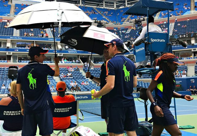 NEW YORK, NY - SEPTEMBER 09: During a break in play umbrellas are used to shield the players from the sun on an intense day of heat during Day Twelve of the 2016 US Open at the USTA Billie Jean King National Tennis Center on September 8, 2016 in Queens. during the Mixed doubles final Laura Siegemund (GER) Mate Pavic (CRO) def. Coco Vandeweghe (USA) [7] Rajeev Ram (USA) [7] (Landon Nordeman for ESPN)