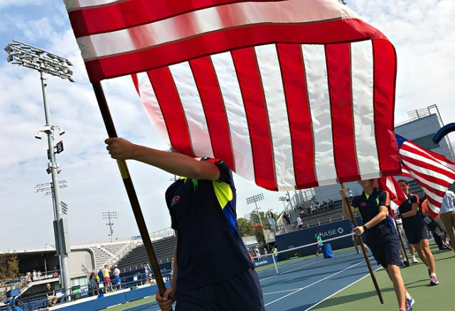 NEW YORK, NY - SEPTEMBER 10: Flag bearers on court 5 after the Men's Collegiate Invitational on Day Thirteen of the 2016 US Open at the USTA Billie Jean King National Tennis Center on September 10, 2016 in Queens. (Landon Nordeman for ESPN)