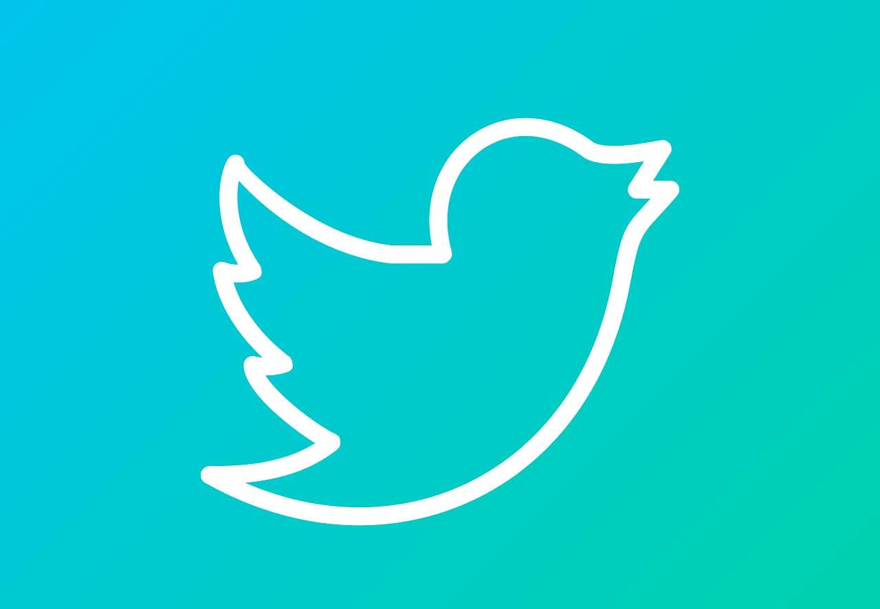 Le logo de Twitter sur fond dégradé